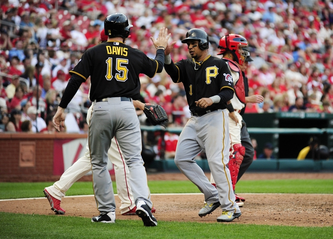 Apr 26, 2014; St. Louis, MO, USA; Pittsburgh Pirates right fielder Jose Tabata (31) high fives pinch hitter Ike Davis (15) after scoring on a single by catcher Tony Sanchez (not pictured) during the ninth inning against the St. Louis Cardinals at Busch Stadium. Pittsburgh defeated St. Louis 6-1. Mandatory Credit: Jeff Curry-USA TODAY Sports