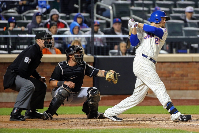 Apr 26, 2014; New York, NY, USA;  New York Mets first baseman Lucas Duda (21) hits a two run single during the third inning against the Miami Marlins at Citi Field. Mandatory Credit: Anthony Gruppuso-USA TODAY Sports