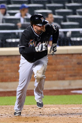 Apr 26, 2014; New York, NY, USA; Miami Marlins third baseman Casey McGehee (9) hits a single during the sixth inning against the New York Mets at Citi Field. Mandatory Credit: Anthony Gruppuso-USA TODAY Sports