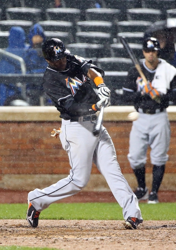 Apr 26, 2014; New York, NY, USA; Miami Marlins shortstop Adeiny Hechavarria (3) hits a RBI single during the sixth inning against the New York Mets at Citi Field. Mandatory Credit: Anthony Gruppuso-USA TODAY Sports