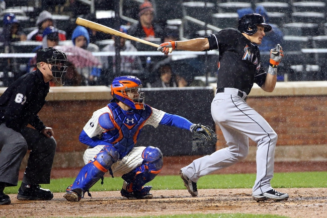 Apr 26, 2014; New York, NY, USA; Miami Marlins second baseman Derek Dietrich (32) grounds into fielders choice advancing a man to third during the sixth inning against the New York Mets at Citi Field. Mandatory Credit: Anthony Gruppuso-USA TODAY Sports