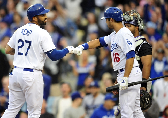 April 26, 2014; Los Angeles, CA, USA; Los Angeles Dodgers center fielder Matt Kemp (27) is greeted by center fielder Andre Ethier (16) after hitting a solo home run in the third inning against the Colorado Rockies at Dodger Stadium. Mandatory Credit: Gary Vasquez-USA TODAY Sports