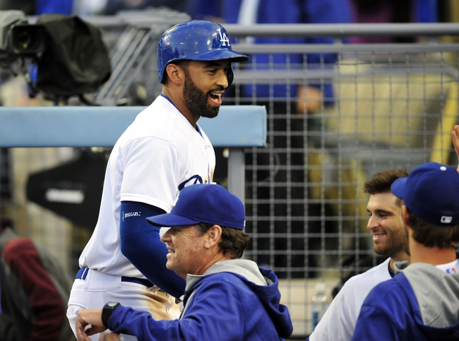 April 26, 2014; Los Angeles, CA, USA; Los Angeles Dodgers center fielder Matt Kemp (27) reacts after hitting a solo home run in the third inning against the Colorado Rockies at Dodger Stadium. Mandatory Credit: Gary Vasquez-USA TODAY Sports