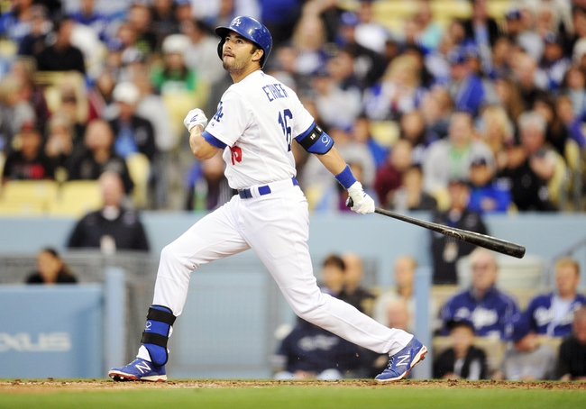 April 26, 2014; Los Angeles, CA, USA; Los Angeles Dodgers center fielder Andre Ethier (16) hits a single in the third inning against the Colorado Rockies at Dodger Stadium. Mandatory Credit: Gary Vasquez-USA TODAY Sports