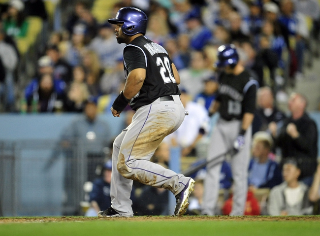 April 26, 2014; Los Angeles, CA, USA; Colorado Rockies catcher Wilin Rosario (20) scores a run in the fifth inning against the Los Angeles Dodgers at Dodger Stadium. Mandatory Credit: Gary Vasquez-USA TODAY Sports