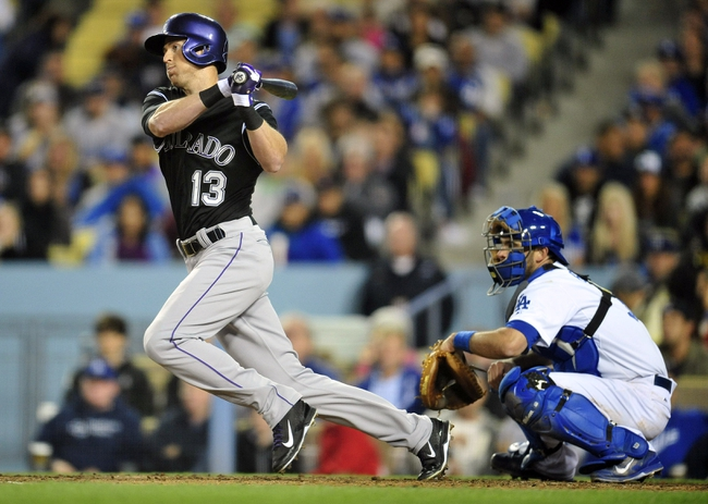 April 26, 2014; Los Angeles, CA, USA; Colorado Rockies left fielder Drew Stubbs (13) hits a single in the fifth inning against the Los Angeles Dodgers at Dodger Stadium. Mandatory Credit: Gary Vasquez-USA TODAY Sports