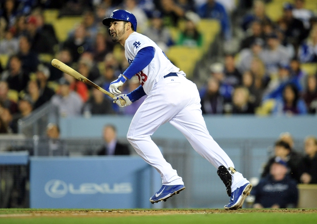 April 26, 2014; Los Angeles, CA, USA; Los Angeles Dodgers first baseman Adrian Gonzalez (23) hits a solo home run in the fifth inning against the Colorado Rockies at Dodger Stadium. Mandatory Credit: Gary Vasquez-USA TODAY Sports