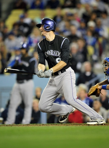 April 26, 2014; Los Angeles, CA, USA; Colorado Rockies  second baseman DJ LeMahieu at bat in the fifth inning against the Los Angeles Dodgers at Dodger Stadium. Mandatory Credit: Gary Vasquez-USA TODAY Sports