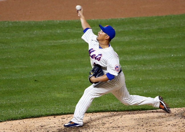Apr 26, 2014; New York, NY, USA; New York Mets relief pitcher Daisuke Matsuzaka (16) pitches during the eighth inning against the Miami Marlins at Citi Field. Miami Marlins won 7-6 in ten innings. Mandatory Credit: Anthony Gruppuso-USA TODAY Sports
