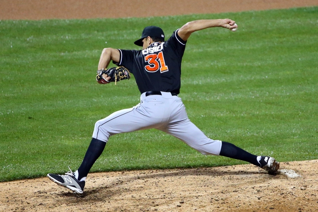 Apr 26, 2014; New York, NY, USA;  Miami Marlins relief pitcher Steve Cishek (31) pitches during the tenth inning against the New York Mets at Citi Field. Miami Marlins won 7-6 in ten innings. Mandatory Credit: Anthony Gruppuso-USA TODAY Sports