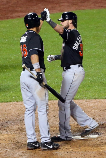 Apr 26, 2014; New York, NY, USA; Miami Marlins catcher Jarrod Saltalamacchia (39) celebrates with Garrett Jones after a solo home run during the tenth inning against the New York Mets at Citi Field. Miami Marlins won 7-6 in ten innings. Mandatory Credit: Anthony Gruppuso-USA TODAY Sports