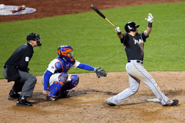 Apr 26, 2014; New York, NY, USA;  Miami Marlins catcher Jarrod Saltalamacchia (39) hits a home run to left during the tenth inning against the New York Mets at Citi Field. Miami Marlins won 7-6 in ten innings. Mandatory Credit: Anthony Gruppuso-USA TODAY Sports