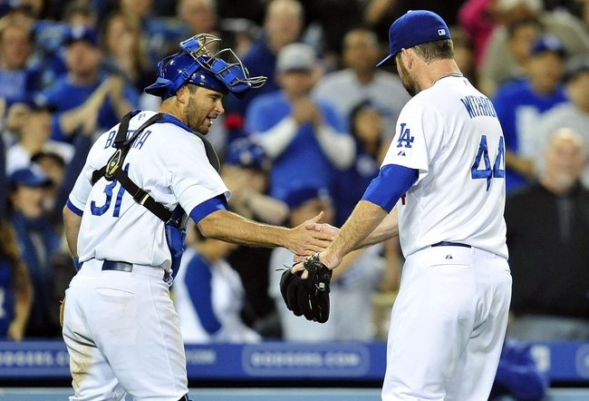 April 26, 2014; Los Angeles, CA, USA; Los Angeles Dodgers catcher Drew Butera (31) congratulates relief pitcher Chris Withrow (44) after pitching the eighth inning against the Colorado Rockies at Dodger Stadium. Mandatory Credit: Gary Vasquez-USA TODAY Sports