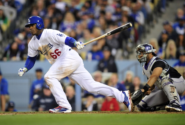 April 26, 2014; Los Angeles, CA, USA; Los Angeles Dodgers right fielder Yasiel Puig (66) hits an RBI single in the fourth inning against the Colorado Rockies at Dodger Stadium. Mandatory Credit: Gary Vasquez-USA TODAY Sports