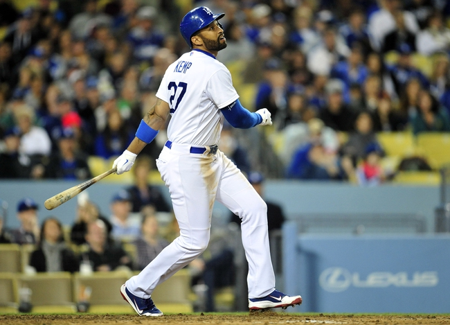 April 26, 2014; Los Angeles, CA, USA; Los Angeles Dodgers center fielder Matt Kemp (27) hits a single in the seventh inning against the Colorado Rockies at Dodger Stadium. Mandatory Credit: Gary Vasquez-USA TODAY Sports