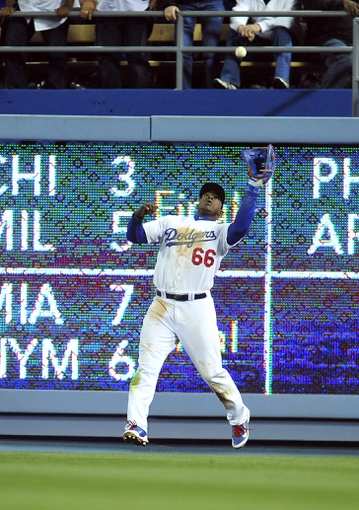 April 26, 2014; Los Angeles, CA, USA; Los Angeles Dodgers right fielder Yasiel Puig (66) catches a fly ball in the eighth inning against the Colorado Rockies at Dodger Stadium. Mandatory Credit: Gary Vasquez-USA TODAY Sports