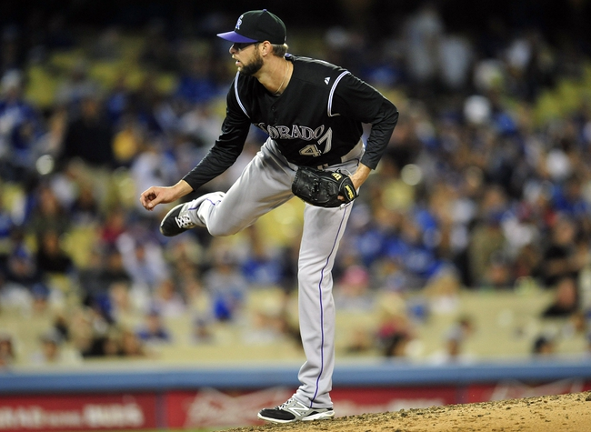 April 26, 2014; Los Angeles, CA, USA; Colorado Rockies relief pitcher Chris Martin (47) pitches the seventh inning against the Los Angeles Dodgers at Dodger Stadium. Mandatory Credit: Gary Vasquez-USA TODAY Sports