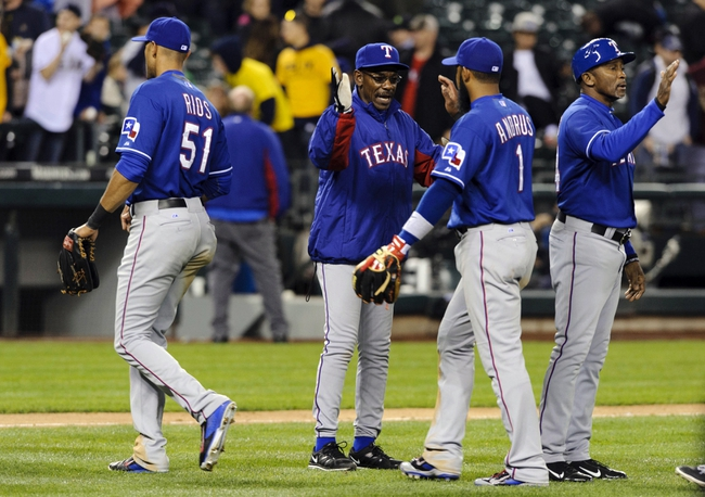 Apr 26, 2014; Seattle, WA, USA; The Texas Rangers celebrate after defeating the Seattle Mariners at Safeco Field. Texas defeated Seattle 6-3. Mandatory Credit: Steven Bisig-USA TODAY Sports