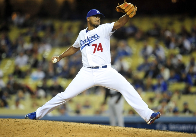 April 26, 2014; Los Angeles, CA, USA; Los Angeles Dodgers relief pitcher Kenley Jansen (74) pitches the ninth inning against the Colorado Rockies at Dodger Stadium. Mandatory Credit: Gary Vasquez-USA TODAY Sports
