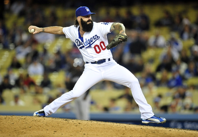 April 26, 2014; Los Angeles, CA, USA; Los Angeles Dodgers relief pitcher Brian Wilson (00) pitches the ninth inning against the Colorado Rockies at Dodger Stadium. Mandatory Credit: Gary Vasquez-USA TODAY Sports