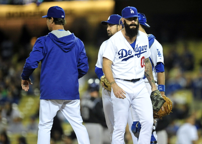 April 26, 2014; Los Angeles, CA, USA; Los Angeles Dodgers relief pitcher Brian Wilson (00) is relieved in the ninth inning at Dodger Stadium. Mandatory Credit: Gary Vasquez-USA TODAY Sports