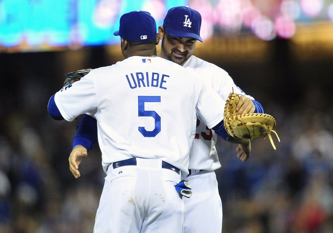 April 26, 2014; Los Angeles, CA, USA; Los Angeles Dodgers first baseman Adrian Gonzalez (23) and third baseman Juan Uribe (5) celebrate the 6-3 victory against the Colorado Rockies at Dodger Stadium. Mandatory Credit: Gary Vasquez-USA TODAY Sports