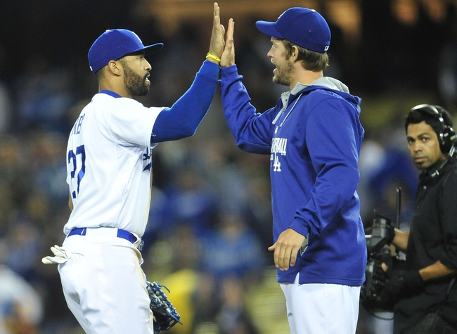 April 26, 2014; Los Angeles, CA, USA; Los Angeles Dodgers center fielder Matt Kemp (27) and starting pitcher Clayton Kershaw (22) celebrate the 6-3 victory against the Colorado Rockies at Dodger Stadium. Mandatory Credit: Gary Vasquez-USA TODAY Sports