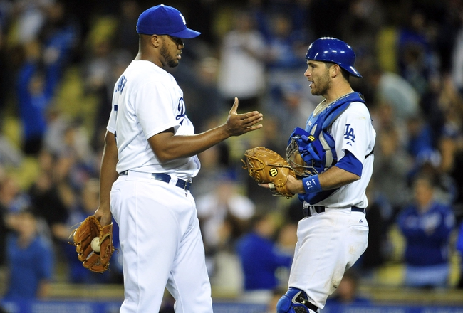 April 26, 2014; Los Angeles, CA, USA; Los Angeles Dodgers relief pitcher Kenley Jansen (74) and catcher Drew Butera (31) celebrate the 6-3 victory against the Colorado Rockies at Dodger Stadium. Mandatory Credit: Gary Vasquez-USA TODAY Sports