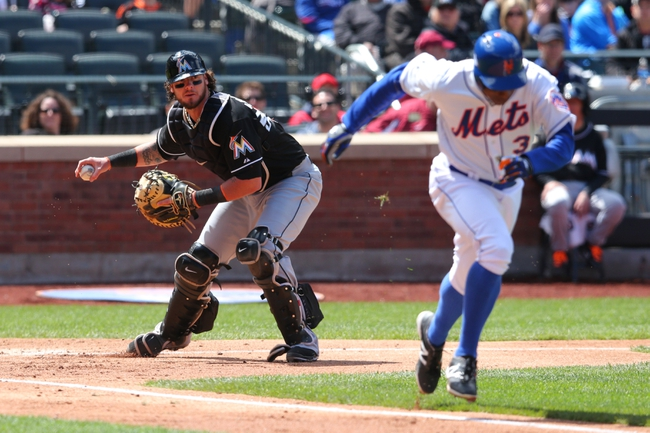 Apr 27, 2014; New York, NY, USA; Miami Marlins catcher Jarrod Saltalamacchia (39) throws out New York Mets right fielder Curtis Granderson (3) on an infield ground ball during the third inning of a game at Citi Field. Mandatory Credit: Brad Penner-USA TODAY Sports