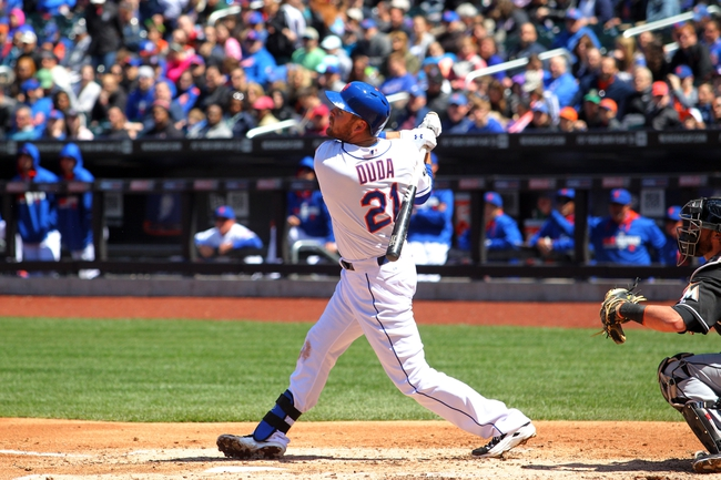 Apr 27, 2014; New York, NY, USA; New York Mets first baseman Lucas Duda (21) hits an RBI ground-rule double against the Miami Marlins during the second inning of a game at Citi Field. Mandatory Credit: Brad Penner-USA TODAY Sports