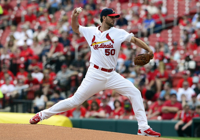 Apr 27, 2014; St. Louis, MO, USA; St. Louis Cardinals starting pitcher Adam Wainwright (50) throws to a Pittsburgh Pirates batter during the first inning at Busch Stadium. Mandatory Credit: Jeff Curry-USA TODAY Sports