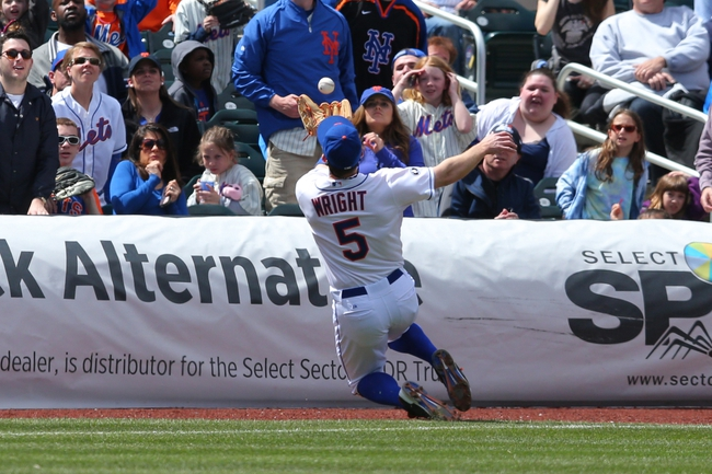 Apr 27, 2014; New York, NY, USA; New York Mets third baseman David Wright (5) catches a pop foul by Miami Marlins third baseman Casey McGehee (not pictured) during the fourth inning of a game at Citi Field. Mandatory Credit: Brad Penner-USA TODAY Sports