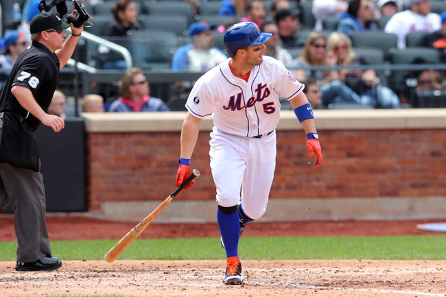 Apr 27, 2014; New York, NY, USA; New York Mets third baseman David Wright (5) hits an RBI double against the Miami Marlins during the fifth inning of a game at Citi Field. Mandatory Credit: Brad Penner-USA TODAY Sports