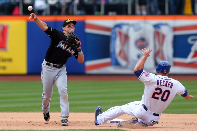Apr 27, 2014; New York, NY, USA; New York Mets catcher Anthony Recker (20) is out at second base as Miami Marlins second baseman Derek Dietrich (32) throws to first to double up New York Mets shortstop Ruben Tejada (not pictured) during the ninth inning of a game at Citi Field. Mandatory Credit: Brad Penner-USA TODAY Sports