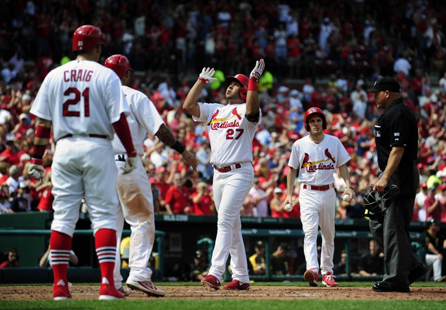 Apr 27, 2014; St. Louis, MO, USA; St. Louis Cardinals shortstop Jhonny Peralta (27) reacts after hitting a three run home run off Pittsburgh Pirates starting pitcher Edinson Volquez (not pictured) during the sixth inning at Busch Stadium. Mandatory Credit: Jeff Curry-USA TODAY Sports