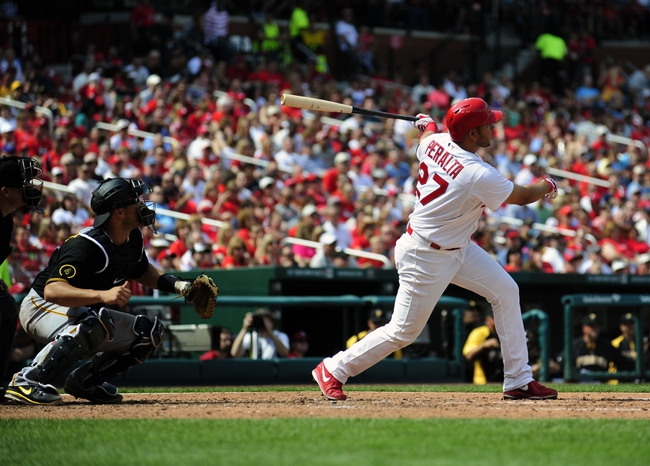 Apr 27, 2014; St. Louis, MO, USA; St. Louis Cardinals shortstop Jhonny Peralta (27) hits a three run home run off of Pittsburgh Pirates starting pitcher Edinson Volquez (not pictured) during the sixth inning at Busch Stadium. Mandatory Credit: Jeff Curry-USA TODAY Sports