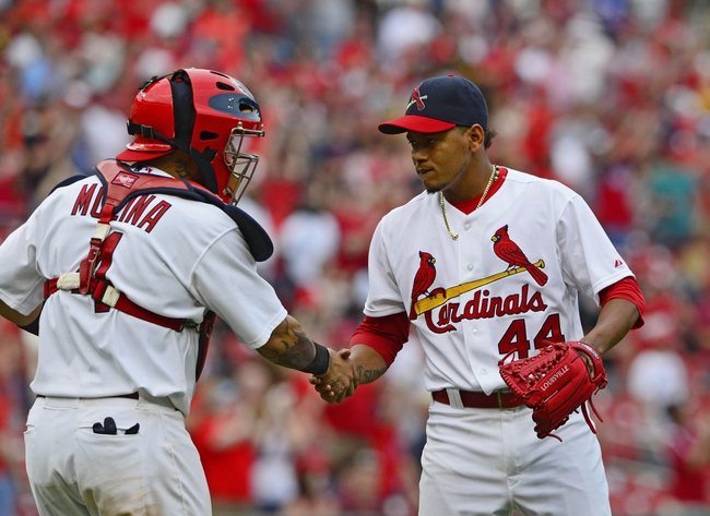 Apr 27, 2014; St. Louis, MO, USA; St. Louis Cardinals relief pitcher Carlos Martinez (44) celebrates with catcher Yadier Molina (4) after defeating the Pittsburgh Pirates 7-0 at Busch Stadium. Mandatory Credit: Jeff Curry-USA TODAY Sports