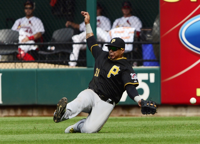Apr 27, 2014; St. Louis, MO, USA; Pittsburgh Pirates right fielder Jose Tabata (31) slides unsuccessfully for a ball hit by St. Louis Cardinals first baseman Matt Adams (not pictured) during the eighth inning at Busch Stadium. St. Louis defeated Pittsburgh 7-0. Mandatory Credit: Jeff Curry-USA TODAY Sports