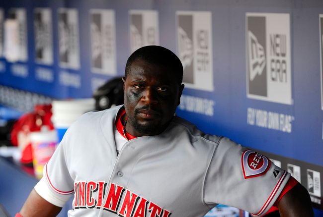 Apr 27, 2014; Atlanta, GA, USA; Cincinnati Reds second baseman Brandon Phillips (4) shown in the dugout against the Atlanta Braves during the ninth inning at Turner Field. The Braves defeated the Reds 1-0 in ten innings. Mandatory Credit: Dale Zanine-USA TODAY Sports