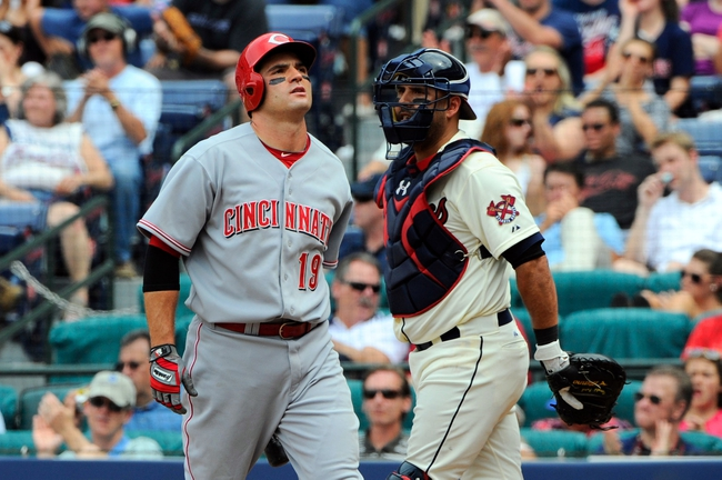 Apr 27, 2014; Atlanta, GA, USA; Cincinnati Reds first baseman Joey Votto (19) reacts after striking out against the Atlanta Braves during the ninth inning at Turner Field. The Braves defeated the Reds 1-0 in ten innings. Mandatory Credit: Dale Zanine-USA TODAY Sports
