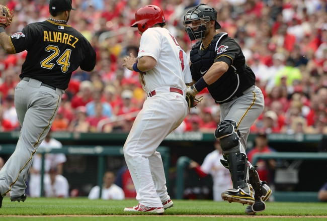 Apr 27, 2014; St. Louis, MO, USA; Pittsburgh Pirates catcher Tony Sanchez (26) tags out St. Louis Cardinals catcher Yadier Molina (4) during the second inning at Busch Stadium. St. Louis defeated Pittsburgh 7-0. Mandatory Credit: Jeff Curry-USA TODAY Sports