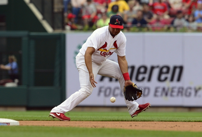 Apr 27, 2014; St. Louis, MO, USA; St. Louis Cardinals shortstop Jhonny Peralta (27) fields a ground ball hit by Pittsburgh Pirates starting pitcher Edinson Volquez (not pictured) during the fifth inning at Busch Stadium. St. Louis defeated Pittsburgh 7-0. Mandatory Credit: Jeff Curry-USA TODAY Sports