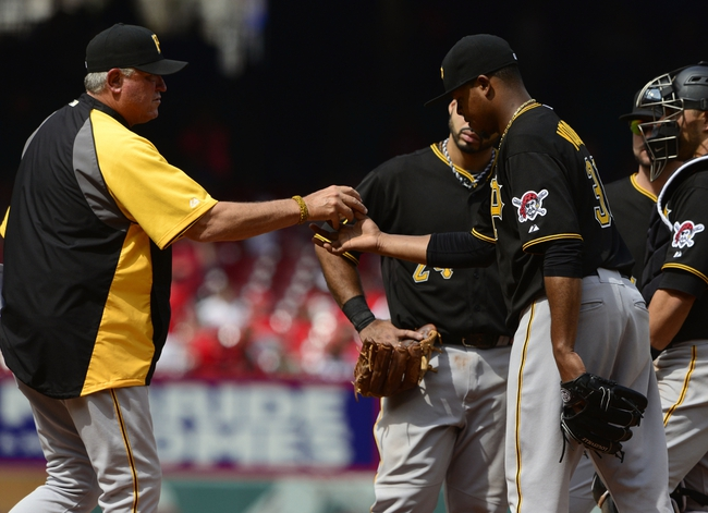 Apr 27, 2014; St. Louis, MO, USA; Pittsburgh Pirates manager Clint Hurdle (13) takes starting pitcher Edinson Volquez (36) out of the game during the sixth inning against the St. Louis Cardinals at Busch Stadium. St. Louis defeated Pittsburgh 7-0. Mandatory Credit: Jeff Curry-USA TODAY Sports