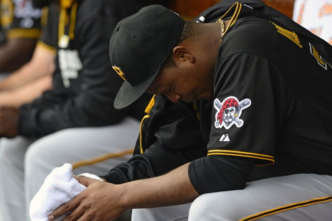 Apr 27, 2014; St. Louis, MO, USA; Pittsburgh Pirates starting pitcher Edinson Volquez (36) sits in the dugout before a game against the St. Louis Cardinals at Busch Stadium. St. Louis defeated Pittsburgh 7-0. Mandatory Credit: Jeff Curry-USA TODAY Sports
