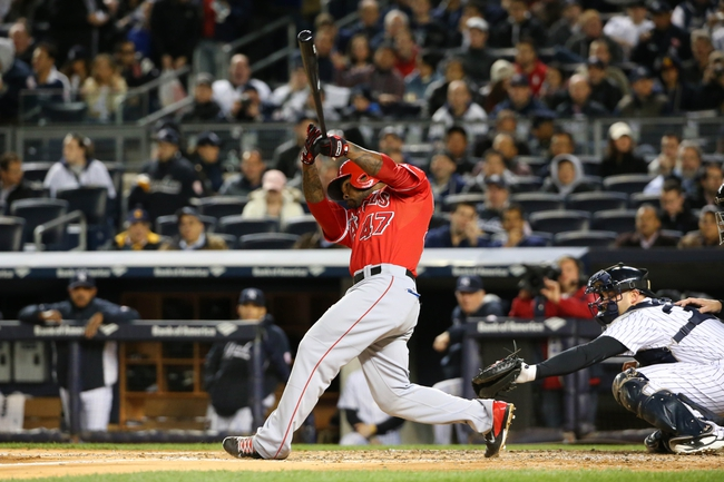 Apr 27, 2014; Bronx, NY, USA;  Los Angeles Angels second baseman Howie Kendrick (47) grounds into a double play during the third inning against the New York Yankees at Yankee Stadium. Mandatory Credit: Anthony Gruppuso-USA TODAY Sports