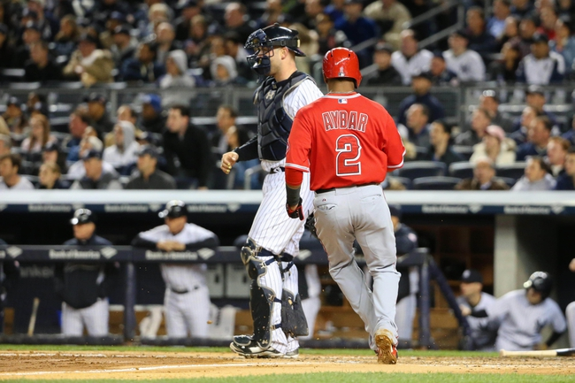 Apr 27, 2014; Bronx, NY, USA;  Los Angeles Angels shortstop Erick Aybar (2) crosses the plate to score during the fourth inning against the New York Yankees at Yankee Stadium. Mandatory Credit: Anthony Gruppuso-USA TODAY Sports