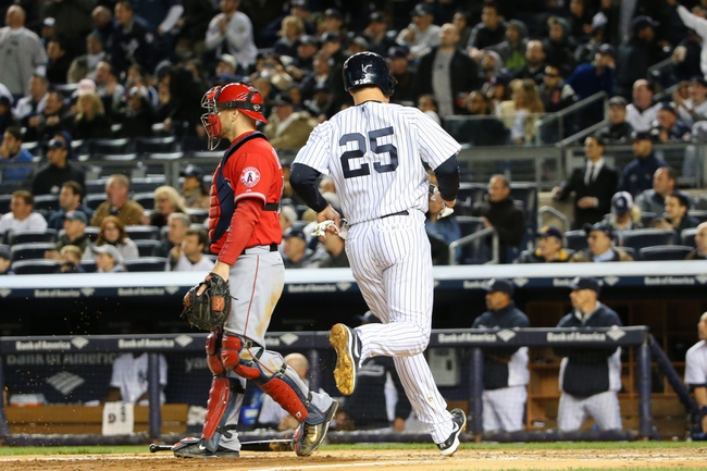 Apr 27, 2014; Bronx, NY, USA;  New York Yankees first baseman Mark Teixeira (25) crosses the plate to score on a hit by right fielder Ichiro Suzuki (31) (not pictured) during the fifth inning against the Los Angeles Angels at Yankee Stadium. Mandatory Credit: Anthony Gruppuso-USA TODAY Sports