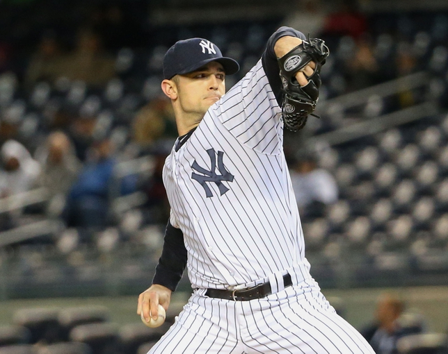 Apr 27, 2014; Bronx, NY, USA;  New York Yankees relief pitcher David Robertson (30) delivers a pitch during the ninth inning against the Los Angeles Angels at Yankee Stadium. New York Yankees won 3-2.  Mandatory Credit: Anthony Gruppuso-USA TODAY Sports
