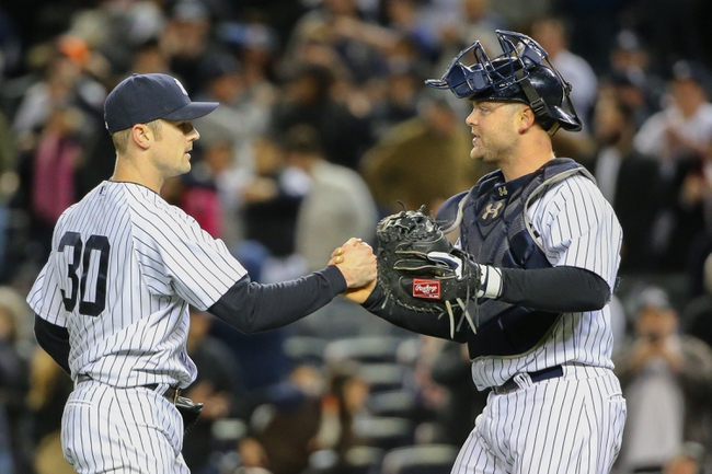 Apr 27, 2014; Bronx, NY, USA;  New York Yankees relief pitcher David Robertson (30) and New York Yankees catcher Brian McCann (34) celebrate the win against the Los Angeles Angels at Yankee Stadium. New York Yankees won 3-2.  Mandatory Credit: Anthony Gruppuso-USA TODAY Sports