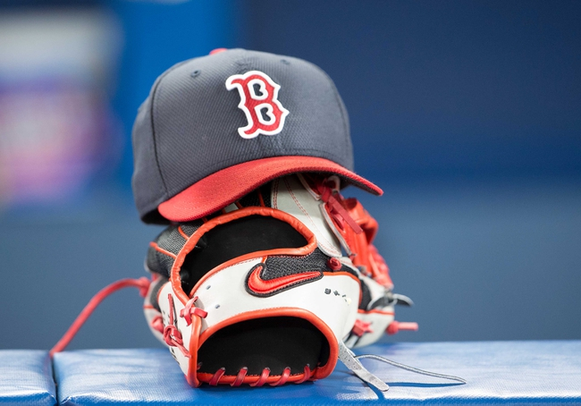 Apr 25, 2014; Toronto, Ontario, CAN; A Boston Red Sox baseball cap and glove sit in the dugout during the warm-up in a game against the Toronto Blue Jays at Rogers Centre. The Boston Red Sox won 8-1. Mandatory Credit: Nick Turchiaro-USA TODAY Sports